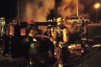 Firefighters from the Occidental Volunteer Fire Department practice fighting a van fire during a training exercise Occidental California