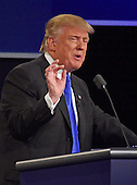 Businessman Donald J. Trump, the Republican Party nominee for President of the United States, makes a point as he appears with former US Secretary of State Hillary Clinton, the Democratic Party nominee for President of the US in the first of three presidential general election debates at Hofstra University in Hempstead, New York on Monday, September 26, 2016.<br /> Credit: Ron Sachs / CNP<br /> (RESTRICTION: NO New York or New Jersey Newspapers or newspapers within a 75 mile radius of New York City)