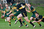 F. Samuelu evades the diving tackle of J. Callander & now looks to outsprint M. McKinnon. Counties Manukau Premier club rugby game between Bombay & Pukekohe played at Bombay on the 19th of May 2007. Pukekohe led 24 - 0 at halftime & went on to win 30 - 22.