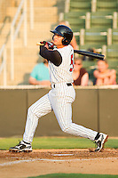 Michael Johnson #5 of the Kannapolis Intimidators follows through on his swing against the Delmarva Shorebirds at CMC-Northeast Stadium on June 21, 2012 in Kannapolis, North Carolina.  The Intimidators defeated the Shorebirds 6-5 in 11 innings.  (Brian Westerholt/Four Seam Images)
