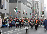 March 27, 2013, Tokyo, Japan - Members of a civil group preserving tradition and spirits of ancient firefighters parade with their standards in a procession in the rain through the main street of Tokyo's Ginza shopping district on Wednesday, March 27, 2013, in celebration of the grand opening of new Kabuki theater. Some 60 leading Kabuki actors took part in the parade prior to the grand opening of the theater for Japan's centuries-old performing arts of Kabuki slated for April 2. (Photo by Kaku Kurita/AFLO)