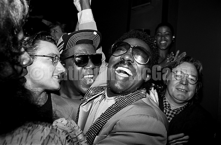 "NEW YORK - AUGUST 13:  American R&B and soul singer Wilson Pickett (1941-2006), center, immediately after  performsing at a party for the release of the film ""The Commitments"" on August 13, 1991  in New York City, New York. The film's director, Alan Parker, is on far right. (Photo by Catherine McGann).Copyright 2010 Catherine McGann"
