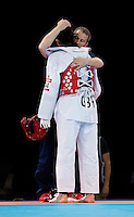 10 AUG 2012 - LONDON, GBR - Sarah Stevenson (GBR) (left) of Great Britain is comforted by her husband and coach Steve Jennings (right) after her women's -67kg category preliminary round contest defeat to Paige McPherson during the London 2012 Olympic Games Taekwondo at Excel in London, Great Britain .(PHOTO (C) 2012 NIGEL FARROW)