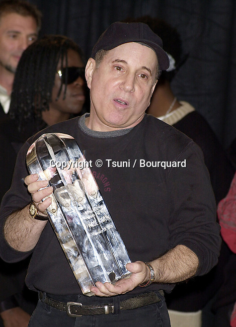 Paul Simon receiving  the MusiCares 2001, person of the year , Century Plaza In Los Angeles. Feb 19, 2001<br />           -            SimonPaul01A.jpg