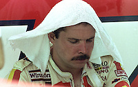 Jimmy Horton sits in the pits after being overcome by fumes while driving in the the Pepsi 400 at Daytona International Speedway, Daytona Beach, FL, July 7, 1990 (Photo by Brian Cleary/www.bcpix.com)