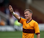 Steven Hammell waving at his family after the match