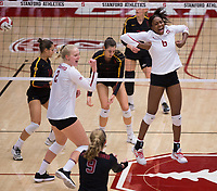 STANFORD, CA - November 15, 2017: Kathryn Plummer, Tami Alade. Morgan Hentz at Maples Pavilion. The Stanford Cardinal defeated USC 3-0 to claim the Pac-12 conference title.