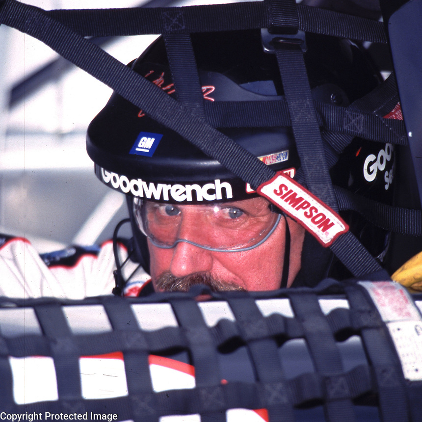NASCAR driver Dale Earnhardt peers out of his race car as he waits to qualify at Darlington, SC on Friday 9/1/00. (Photo by Brian Cleary)