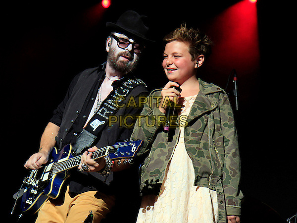 Dave Stewart & Kaya Stewart .opened for country duo Sugarland at the Verizon Wireless Amphitheater, Alpharetta, GA, USA, August 23rd, 2012..music on stage concert live half length black hat sunglasses waistcoat shirt playing guitar beige trousers father family dad daughter singing microphone  .CAP/ADM/DH.©Dan Harr/AdMedia/Capital Pictures.