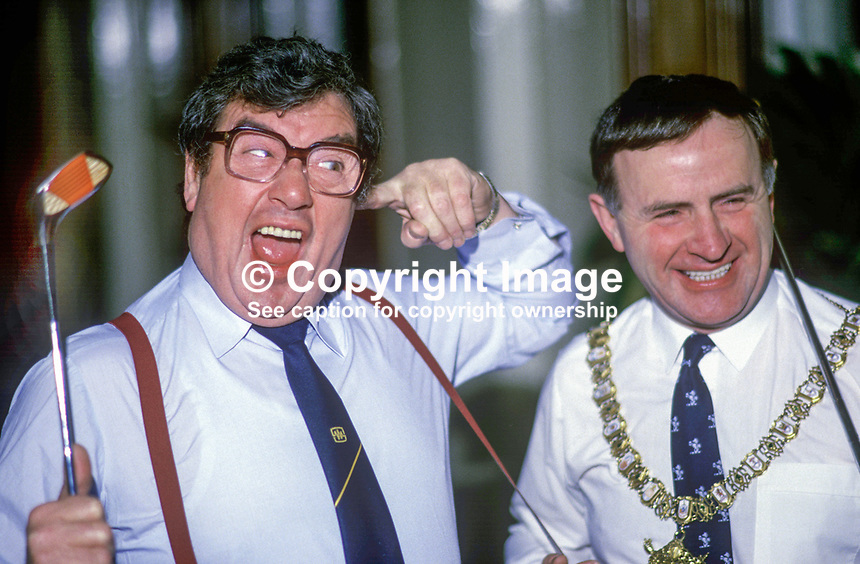 Frank Carson, born Belfast, N Ireland, comedian, comic, actor, with Lord Mayor or Belfast, John Carson, to announce a charity golf event. 19860103FC3.<br />