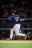 Mobile BayBears shortstop Riley Unroe (19) follows through on a swing during a game against the Jacksonville Jumbo Shrimp on April 14, 2018 at Baseball Grounds of Jacksonville in Jacksonville, Florida.  Mobile defeated Jacksonville 13-3.  (Mike Janes/Four Seam Images)