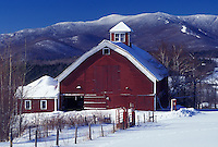barn, Vermont, VT, Mad River, Scenic view of red barn in Warren in the Mad River Valley in winter with the snow-covered Green Mountains and Sugarbush Ski Area in the background in winter.