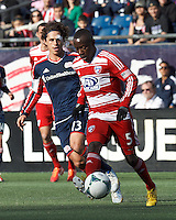 FC Dallas defender Jair Benitez (5) passes the ball as New England Revolution midfielder Ryan Guy (13) defends..  In a Major League Soccer (MLS) match, FC Dallas (red) defeated the New England Revolution (blue), 1-0, at Gillette Stadium on March 30, 2013.