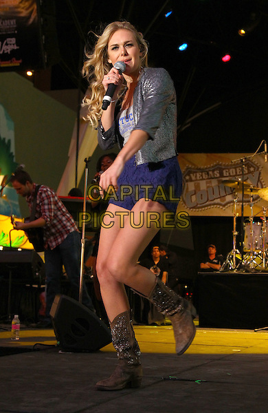 Laura Bell Bundy.2012 ACM Weekend on Fremont Street Experience, Las Vegas, Nevada, USA,31st March 2012..music country live in concert on stage gig half length microphone singing blue shorts  cowboy boots silver metallic jacket .CAP/ADM/MJT.© MJT/AdMedia/Capital Pictures.