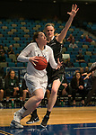 Idaho's Geraldine McCorkell drives the baseline past Portland State's Courtney West in a women's Big Sky Tournament semi-final game held at the Reno Events Center on Friday, March 9, 2018 in Reno, Nevada.