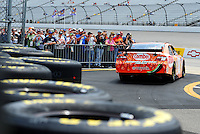 May 1, 2009; Richmond, VA, USA; Fans look on as NASCAR Sprint Cup Series driver Kyle Busch heads out on track during practice for the Russ Friedman 400 at the Richmond International Raceway. Mandatory Credit: Mark J. Rebilas-