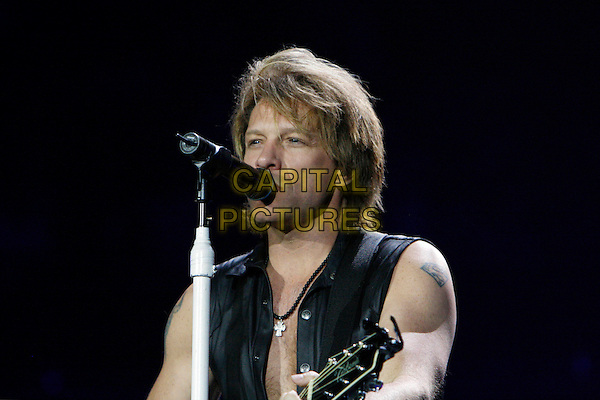 BON JOVI - JON BON JOVI (John Francis Bongiovi, Jr.).Play live at the O2 Arena, London, England, UK, June 22nd 2010..music concert gig on stage half length sleeveless black shirt microphone singing Superman logo crest tattoo.CAP/MAR.© Martin Harris/Capital Pictures.