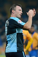 Wycombe Wanderers Garry Thompson applauds the travelling supporters as he is substituted during the Sky Bet League 2 match between Mansfield Town and Wycombe Wanderers at the One Call Stadium, Mansfield, England on 31 October 2015. Photo by Garry Griffiths.