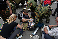 "Members of special pro-Russian batalion ""Vostok"" check personal belongings of workers of town hall during the military coup in DNR (Donetsk Peoples Republic), taking over town hall, held by another group of pro-russian activists."