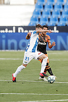 12th July 2020; Estadio Municipal de Butarque, Madrid, Spain; La Liga Football, Club Deportivo Leganes versus Valencia; Ruben Perez (CD Leganes) controls the ball as he is pressured