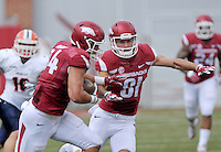 NWA Democrat-Gazette/BEN GOFF @NWABENGOFF<br /> Cody Hollister (81), Arkansas wide receiver, blocks for tight end Hunter Henry on Saturday Sept. 5, 2015 during the first quarter of the game in Razorback Stadium in Fayetteville.