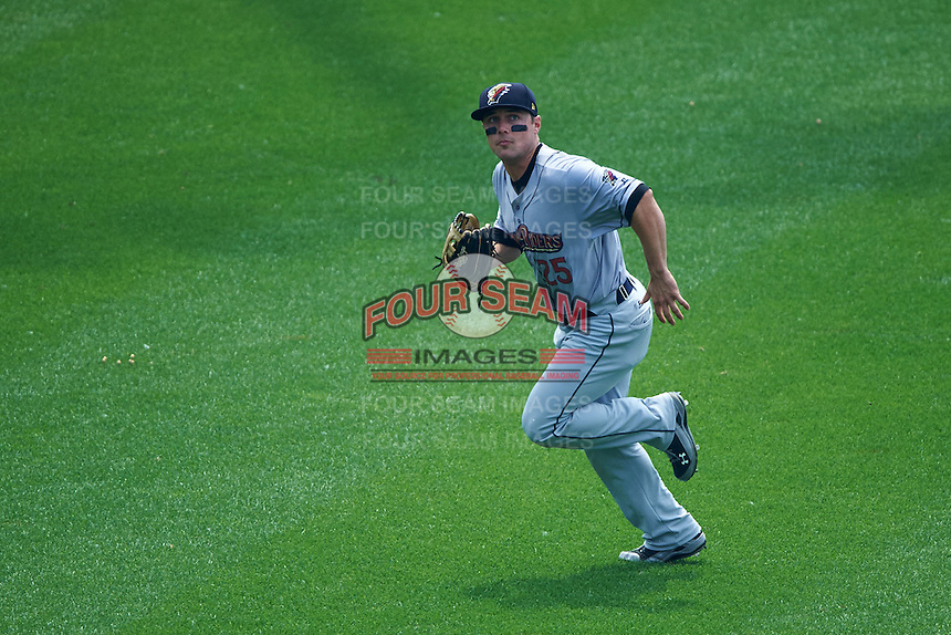 Scranton/Wilkes-Barre RailRiders outfielder Taylor Dugas (25) tracks a fly ball during a game against the Buffalo Bisons on June 10, 2015 at Coca-Cola Field in Buffalo, New York.  Scranton/Wilkes-Barre defeated Buffalo 7-2.  (Mike Janes/Four Seam Images)