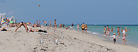 People enyoying excercise, the sun sand and warm ocean waters of beautiful South Beach, Miami Beach Florida.