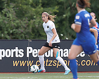 Portland Thorns FC defender Marian Dougherty (2) looks to pass. In a National Women's Soccer League (NWSL) match, Portland Thorns FC (white/black) defeated Boston Breakers (blue), 2-1, at Dilboy Stadium on July 21, 2013.