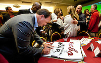 TALLAHASSEE, FLA. 2/2/11-FSUSIGN020211CH-Head Coach Jimbo Fisher signs a banner for a fan at after the 2011 national signing day war party in Tallahassee...COLIN HACKLEY PHOTO