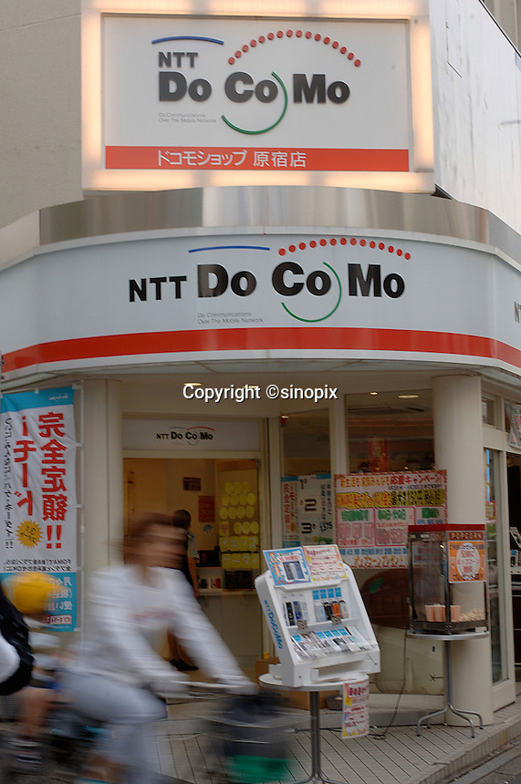 Mobile phones shop by NTT DoCoMo in Tokyo, Japan. Competition within the mature mobile phones market is fierce in Japan..