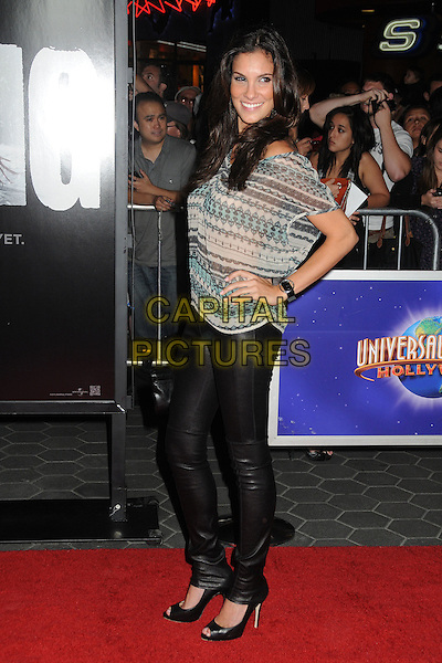 """Daniela Ruah.""""The Thing"""" World Premiere held at AMC Citywalk Stadium 19, Universal City, California, USA..October 10th, 2011.full length black leather trousers hand on hip side grey gray green beige print top.CAP/ADM/BP.©Byron Purvis/AdMedia/Capital Pictures."""