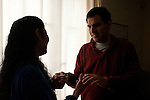 Antonio Orillo communicates with his teacher, Carmen Ortiz. Antonio has limited vision and hearing and communictes mainly by toch and motion.