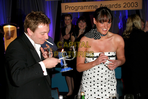 SURANNE JONES.RTS Awards, Grosvenor House, London..16th March 2004..half length cigarette pipe smoking.Ref: BR.www.capitalpictures.com.sales@capitalpictures.com.©Capital Pictures.