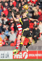 Doncaster Rovers' Jordan Houghton jumps with  Rotherham United's Will Vaulks<br /> <br /> Photographer Mick Walker/CameraSport<br /> <br /> The EFL Sky Bet League One - Doncaster Rovers v Rotherham United - Saturday 11th November 2017 - Keepmoat Stadium - Doncaster<br /> <br /> World Copyright &copy; 2017 CameraSport. All rights reserved. 43 Linden Ave. Countesthorpe. Leicester. England. LE8 5PG - Tel: +44 (0) 116 277 4147 - admin@camerasport.com - www.camerasport.com