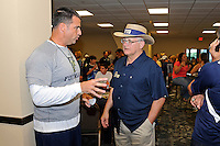 12 August 2011:  FIU Football Head Coach Mario Cristobal speaks with FIU President Mark Rosenberg during the FIU 2011 Panther Preview at University Park Stadium in Miami, Florida.