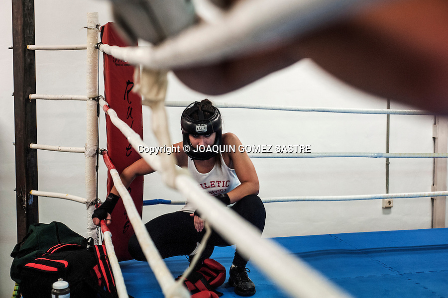 amateur boxer Pilar de la Horadada taking a break after a training session at the Familia boxing club.