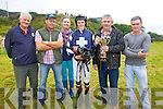 Killorglin Jockey Tadhg O'Sullivan being presented with the Martin Cournane Cup after his win on Quare Times at the Cahersiveen Races on Sunday pictured here l-r; John Murphy, Pat O'Sullivan, Lorraine O'Sullivan, Tadhg O'Sullivan, Paul Cournane & Eoghan O'Sullivan.