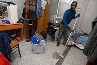 Brescia / Italia 2014<br /> Immigrato in un container alla periferia di Brescia in cui vivono senza casa e richiedenti asilo.<br /> Immigrants in a container on the outskirts of Brescia in which they live homeless and asylum seekers. <br /> Photo by Livio Senigalliesi