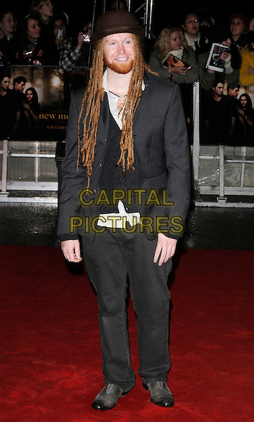 "NEWTON FAULKNER .Attending ""The Twilight Saga: New Moon"" Fan Event at the Battersea Evolution, London, England, UK, November 11th 2009..full length grey gray brown hat suit jacket beard facial hair smiling dreadlocks .CAP/CAN.©Can Nguyen/Capital Pictures."