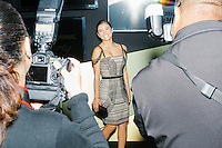 Photographers Darnell Marbury (right) and Maneja Houchin photograph actress Diane Guerrero, of Orange is the New Black, as she arrives at the MSNBC After Party at the United States Institute of Peace in Washington, DC. The party followed the annual White House Correspondents Association Dinner on Saturday, April 30, 2016. The party continued until about 3 AM on Sunday, May 1, 2016.