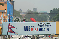 Nepal, Kathmandu, earthquake relief efforts. We Will Rise Again logo on bridge at New Road.