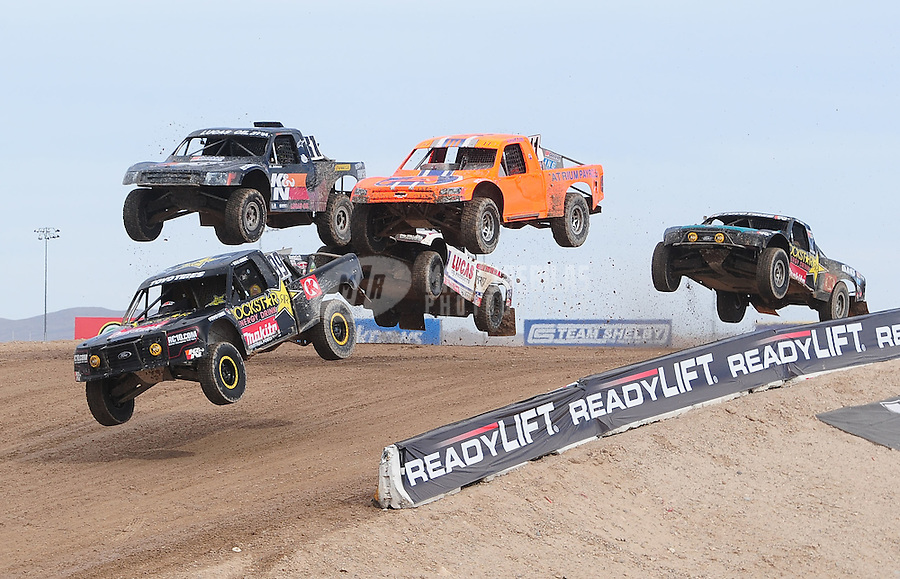 Nov. 6, 2010; Las Vegas, NV USA; LOORRS pro four unlimited drivers Kyle Leduc (99) leads the field over a jump during round 13 at the Las Vegas Motor Speedway short course. Mandatory Credit: Mark J. Rebilas-US PRESSWIRE