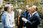 United States President Jimmy Carter, left, chats with Prime Minister Menachem Begin, right, and his party after their meeting at Camp David, near Thurmont, Maryland prior to their meeting on Friday, September 16, 1978.  From left to right: President Carter; Defense Minister Ezer Weizman of Israel, Aliza Begin, wife of the Prime Minister; unidentified; Yehiel Kadishai, Director of the Office of the Prime Minister; and Prime Minister Begin..Credit: White House via CNP