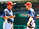 4 July 2010: Washington Nationals pitcher Stephen Strasburg (right) listens to pitching coach Steve McCatty prior to a game against the New York Mets at Nationals Park in Washington, DC. The Mets defeated the Nationals 9-5 in the fourth game and splitting their 4-game series. Mandatory Credit: Ed Wolfstein Photo