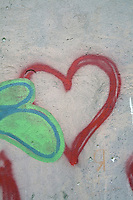 Love hearts spray painted onto a wall
