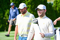 Brandon Grace (RSA) and Marc Leishman (AUS) depart the 4th tee during round 3 Four-Ball of the 2017 President's Cup, Liberty National Golf Club, Jersey City, New Jersey, USA. 9/30/2017.<br /> Picture: Golffile | Ken Murray<br /> <br /> All photo usage must carry mandatory copyright credit (&copy; Golffile | Ken Murray)
