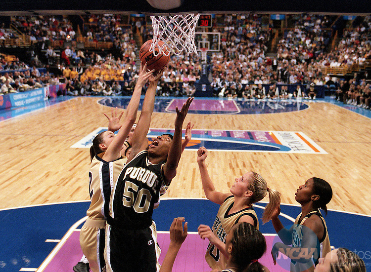 01 APR 2001:  Forward Shereka Wright (50) of Purdue battles for a rebound with guard Alicia Ratay (22) of Notre Dame during the Division 1 Women's Basketball Championships held at the Savvis Center in St. Louis, MO.  Notre Dame defeated Purdue 68-66 for the national championship title.  Jamie Schwaberow/NCAA Photos