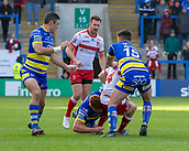 9th February 2019, Halliwell Jones Stadium, Warrington, England; Betfred Super League rugby, Warrington Wolves versus Hull KR; Jimmy Keinhorst is tackled by Danny Walker and Declan Patton