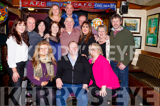 Tiny Callahan seated front centre celebrates a birthday with a big O with his family and friends in the Greyhound Bar on Saturday night last,  <br /> Seated l to r, Niamh, Tiny and Catherine Callaghan.