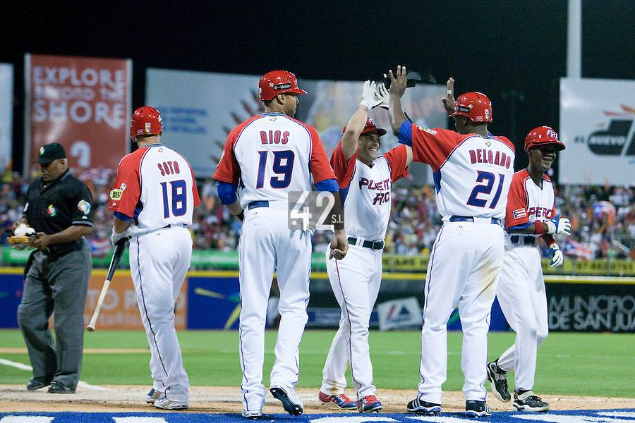 7 March 2009: #7 Ivan Rodriguez of Puerto Rico celebrates with his teammates after his second homerun during the 2009 World Baseball Classic Pool D match at Hiram Bithorn Stadium in San Juan, Puerto Rico. Puerto Rico wins 7-0 over Panama.